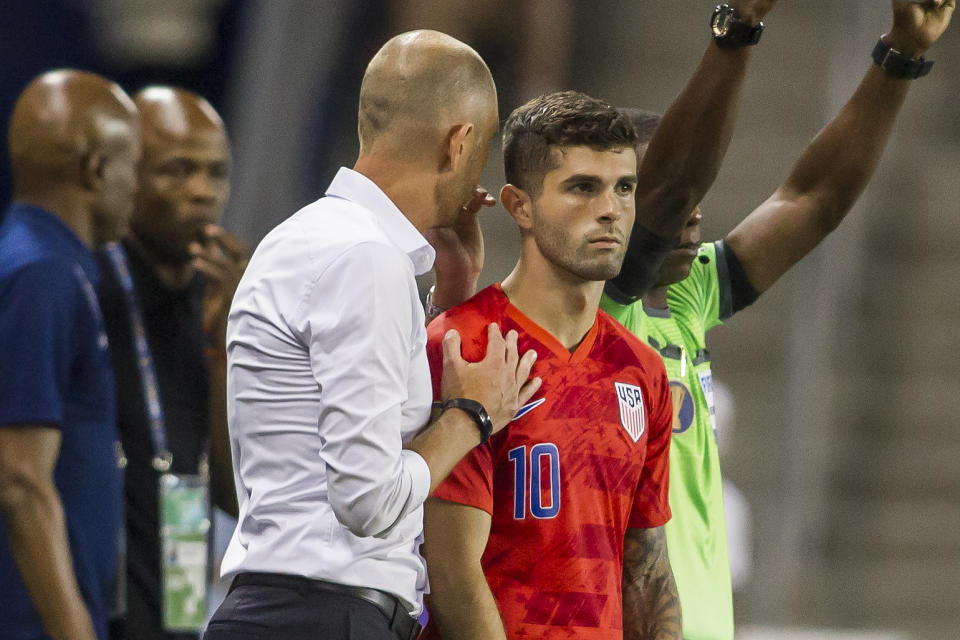 United States coach Gregg Berhalter (left) lauded the progress Christian Pulisic (right) has made during his first season with English Premier League titan Chelsea. (Nick Tre. Smith/Getty Images)