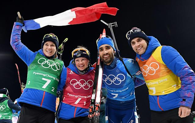 <p>Gold medallistsFrance's Anais Bescond, France's Marie Dorin Habert, France's Martin Fourcade and France's Simon Desthieux celebrate during the victory ceremony in the mixed relay biathlon event during the Pyeongchang 2018 Winter Olympic Games on February 20, 2018, in Pyeongchang. (Getty) </p>