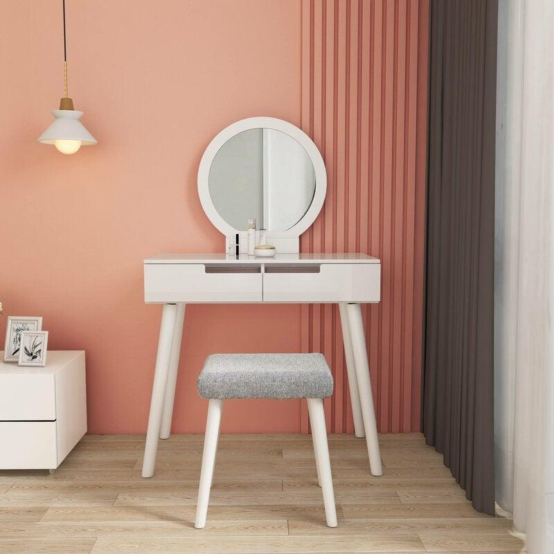 """<h2>31% Off Hashtag Home Elrosa Vanity Set</h2><br><strong>55 reviews and 4.2 out of 5 stars</strong><br>""""I actually got this to use as a desk in my apartment during COVID (just didn't install the mirror). It's super easy to assemble, just screw the legs on."""" <em>– Wayfair Reviewer</em><br><br><em>Shop <strong><a href=""""https://www.wayfair.com/furniture/pdp/hashtag-home-elrosa-makeup-vanity-set-with-stool-and-mirror-w002582110.html"""" rel=""""nofollow noopener"""" target=""""_blank"""" data-ylk=""""slk:Wayfair"""" class=""""link rapid-noclick-resp"""">Wayfair</a></strong></em><br><br><strong>Hashtag Home</strong> Elrosa Makeup Vanity Set with Stool and Mirror, $, available at <a href=""""https://go.skimresources.com/?id=30283X879131&url=https%3A%2F%2Fwww.wayfair.com%2Ffurniture%2Fpdp%2Fhashtag-home-elrosa-makeup-vanity-set-with-stool-and-mirror-w002582110.html"""" rel=""""nofollow noopener"""" target=""""_blank"""" data-ylk=""""slk:Wayfair"""" class=""""link rapid-noclick-resp"""">Wayfair</a>"""