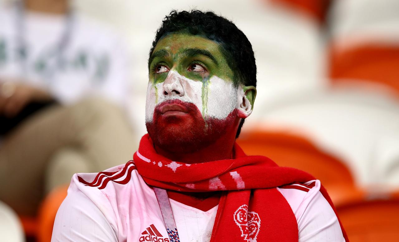 <p>An Iran supporter shows his emotions following defeat during the 2018 FIFA World Cup Russia group B match between Iran and Portugal at Mordovia Arena on June 25, 2018 in Saransk, Russia. (Photo by Maja Hitij – FIFA/FIFA via Getty Images) </p>