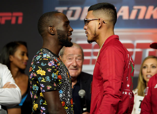 "Boxers Jose Benavidez Jr., right, of Phoenix,, and Terence ""Bud"" Crawford, of Omaha, face each other during a news conference in Omaha, Neb., Thursday, Oct. 11, 2018, ahead of their welterweight WBO world title bout on Saturday. There has been friction between Benavidez and Crawford since February, when Benavidez accused Crawford, the champ, of ducking him. (AP Photo/Nati Harnik)"