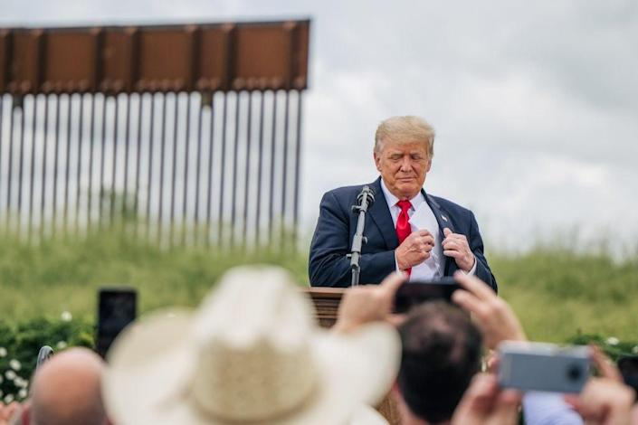 Former President Donald Trump at his unfinished border wall in June, in Pharr, Texas (Getty Images)
