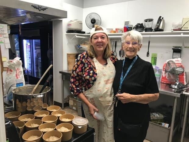 Volunteers Danica Fletcher and Sepkhae Lind work to provide meals distributed to Kamloops residents in need through the Kamloops COVID Meal Train.  (Doug Herbert/CBC - image credit)