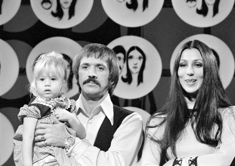 Married American singing and acting duo Sonny Bono (1935 - 1998) (born Salvatore Philip Bono) and Cher (born Cherilyn Sarkisian LaPiere) appear with their daughter Chastity Bono on an episode of the television variety show 'The Sonny and Cher Comedy Hour,' December 17, 1971. (Photo by CBS Photo Archive/Getty Images)