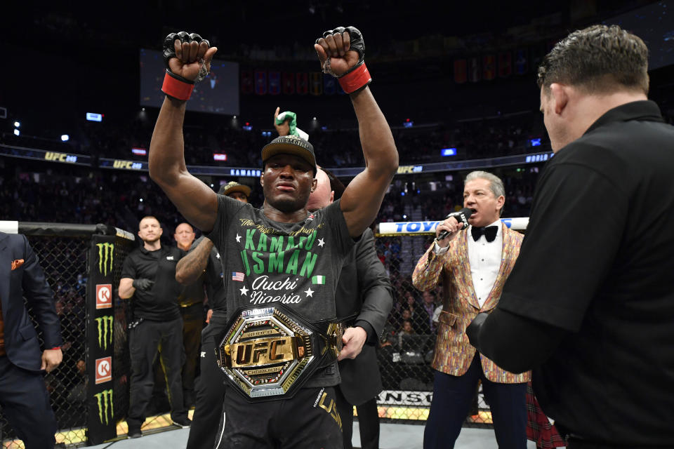 LAS VEGAS, NEVADA - DECEMBER 14:  Kamaru Usman of Nigeria raises his hand in victory over Colby Covington in their UFC welterweight championship bout during the UFC 245 event at T-Mobile Arena on December 14, 2019 in Las Vegas, Nevada. (Photo by Jeff Bottari/Zuffa LLC via Getty Images)