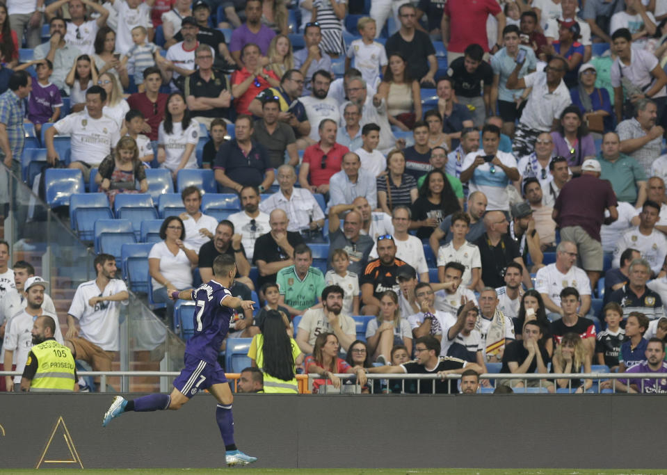 Valladolid's Sergi Guardiola celebrates after scoring his side's first goal during the Spanish La Liga soccer match between Real Madrid and Valladolid at the Santiago Bernabeu stadium in Madrid, Spain, Saturday, Aug. 24, 2019. (AP Photo/Paul White)