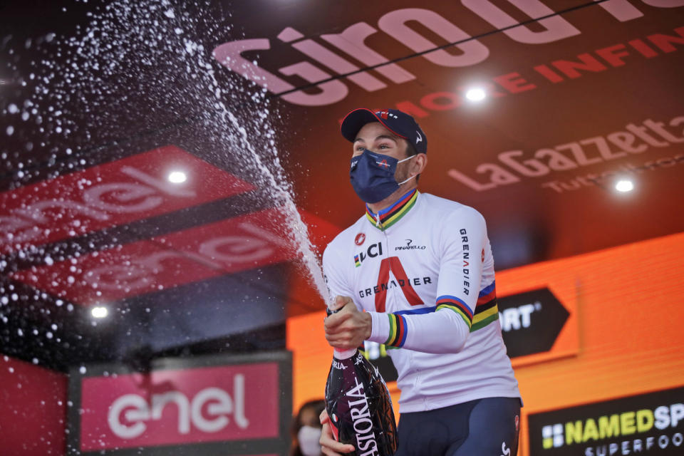 Italy's Filippo Ganna celebrates on the podium after winning the final stage of the Giro d'Italia cycling race, a 15.7 kilometers (9.756 miles) individual time trial from Cernusco sul Naviglio to Milan, Italy, Sunday, Oct. 25, 2020. (AP Photo/Luca Bruno)