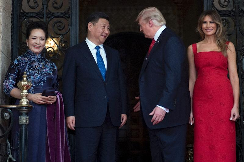 US First Lady Melania Trump (R) and US President Donald Trump (2nd R) welcome Chinese President Xi Jinping (2nd L) and his wife Peng Liyuan (L) to the Mar-a-Lago estate in West Palm Beach, Florida, on April 6, 2017