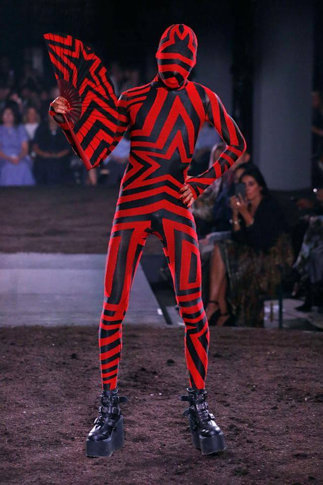 <p>Gareth Pugh sent models down a dirt-laden runway for his SS18 show to symbolise loam for new ideas. In an extra push against industry conventions, models stomped (and twirled) down the catwalk in eccentric bodysuits. <em>[Photo: Getty]</em> </p>