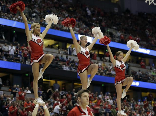 Wisconsin cheerleaders during the first half in a regional final NCAA college basketball tournament game against Arizona, Saturday, March 29, 2014, in Anaheim, Calif. (AP Photo/Alex Gallardo)