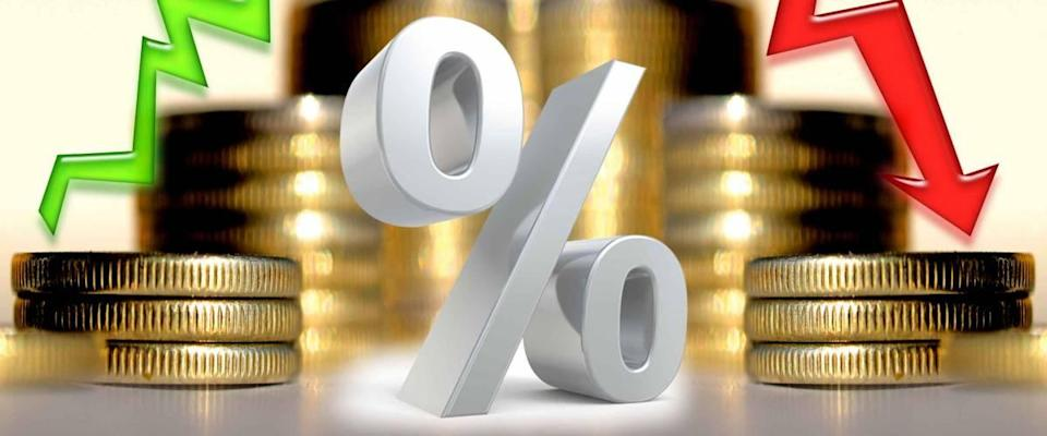 Arrows and percentage symbol on the background of money . The concept of changing financial stability .