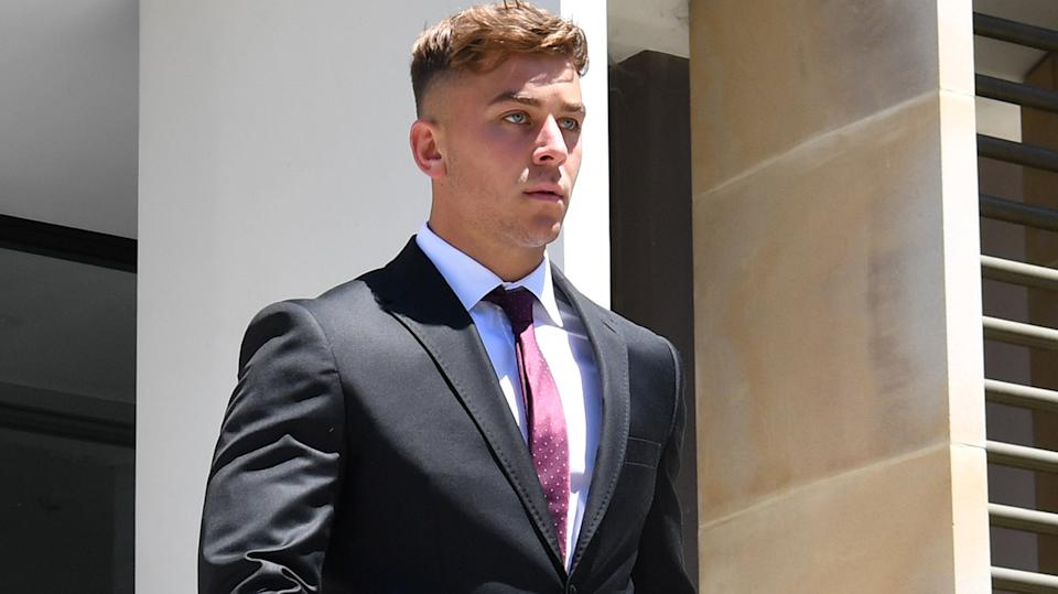 Callan Sinclair, the co-accused with St. George Illawarra Dragons rugby league player Jack de Belin, is seen leaving court.