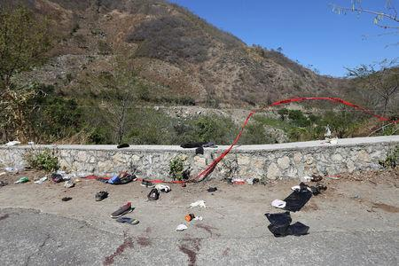 A general view shows clothing and items scattered on the site where a cargo truck careened off a road and turned over, killing at least 25 migrants from Central America, in Francisco Sarabia, Chiapas state, Mexico March 8, 2019. REUTERS/Jacob Garcia