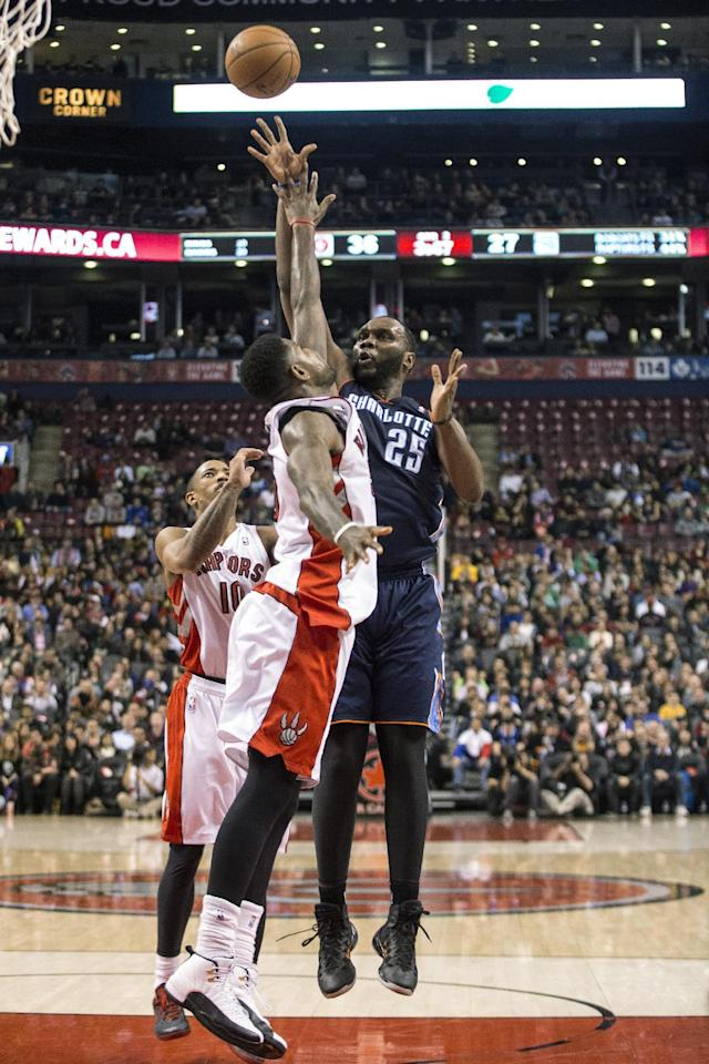Charlotte Bobcats' Al Jefferson shoots over Toronto Raptors' Amir Johnson during the first half of an NBA basketball game in Toronto on Wednesday, Dec. 18, 2013. (AP Photo/The Canadian Press, Chris Young)