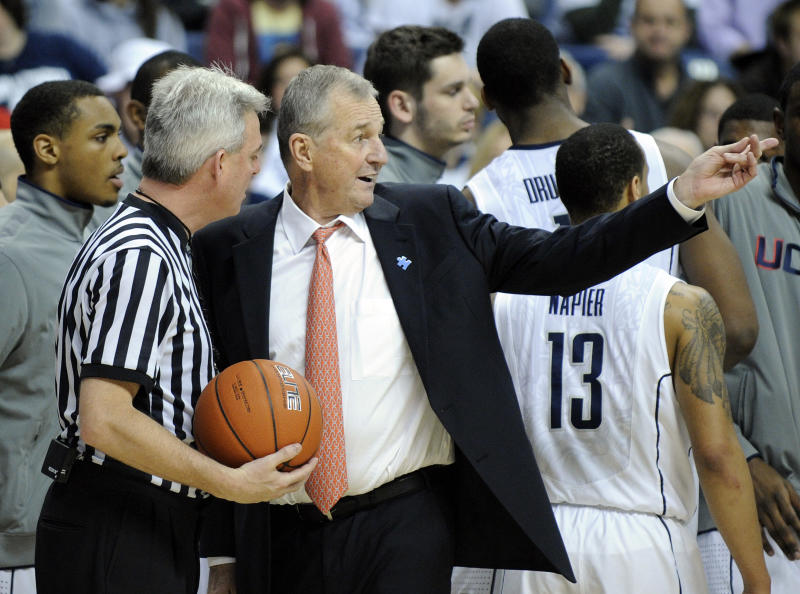 Connecticut coach Jim Calhoun speaks with an official during  the first half of an NCAA college basketball game against Pittsburgh, in Storrs, Conn., on Saturday, March 3, 2012. (AP Photo/Fred Beckham)