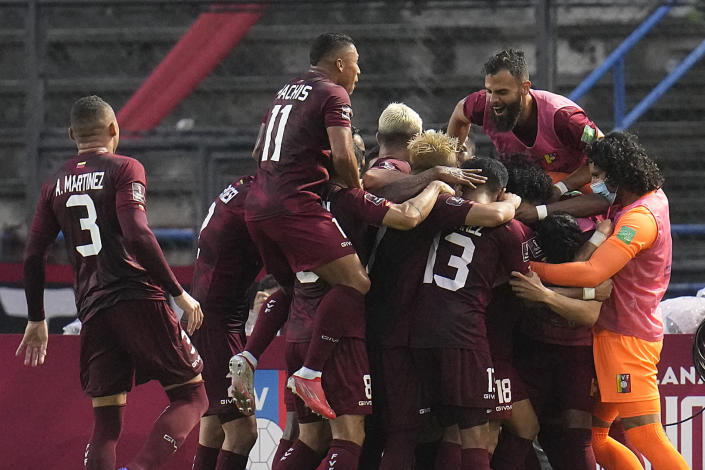 Venezuela's Eduard Bello, center, celebrates with teammates after scoring his side's second goal against Ecuador during a qualifying soccer match for the FIFA World Cup Qatar 2022 at UCV Olympic Stadium in Caracas, Venezuela, Sunday, Oct. 10, 2021. (AP Photo/Ariana Cubillos)