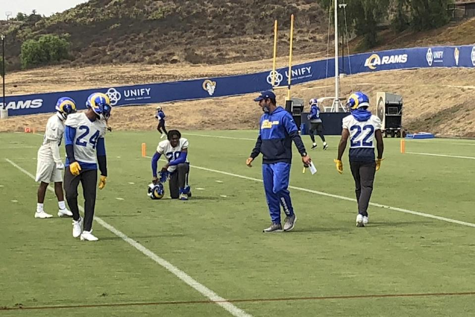 Brandon Staley, second from right, instructs Rams players during a practice session in September.