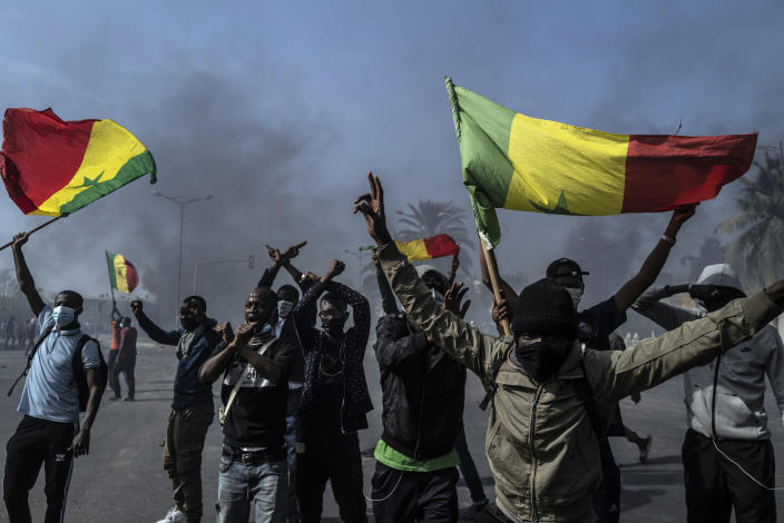 Demonstrators protest against the arrest of opposition leader and former presidential candidate Ousmane Sonko in Dakar, Senegal, Friday, March 5, 2021. Days of violent protests in Senegal have killed at least one person, local reports say, as young people take to the streets nationwide in support of the main opposition leader who was detained Wednesday. (AP Photo/Sylvain Cherkaoui)