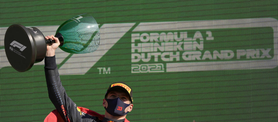 Red Bull driver Max Verstappen of the Netherlands celebrates on the podium after winning the Formula One Dutch Grand Prix, at the Zandvoort racetrack, Netherlands, Sunday, Sept. 5, 2021. (AP Photo/Francisco Seco)