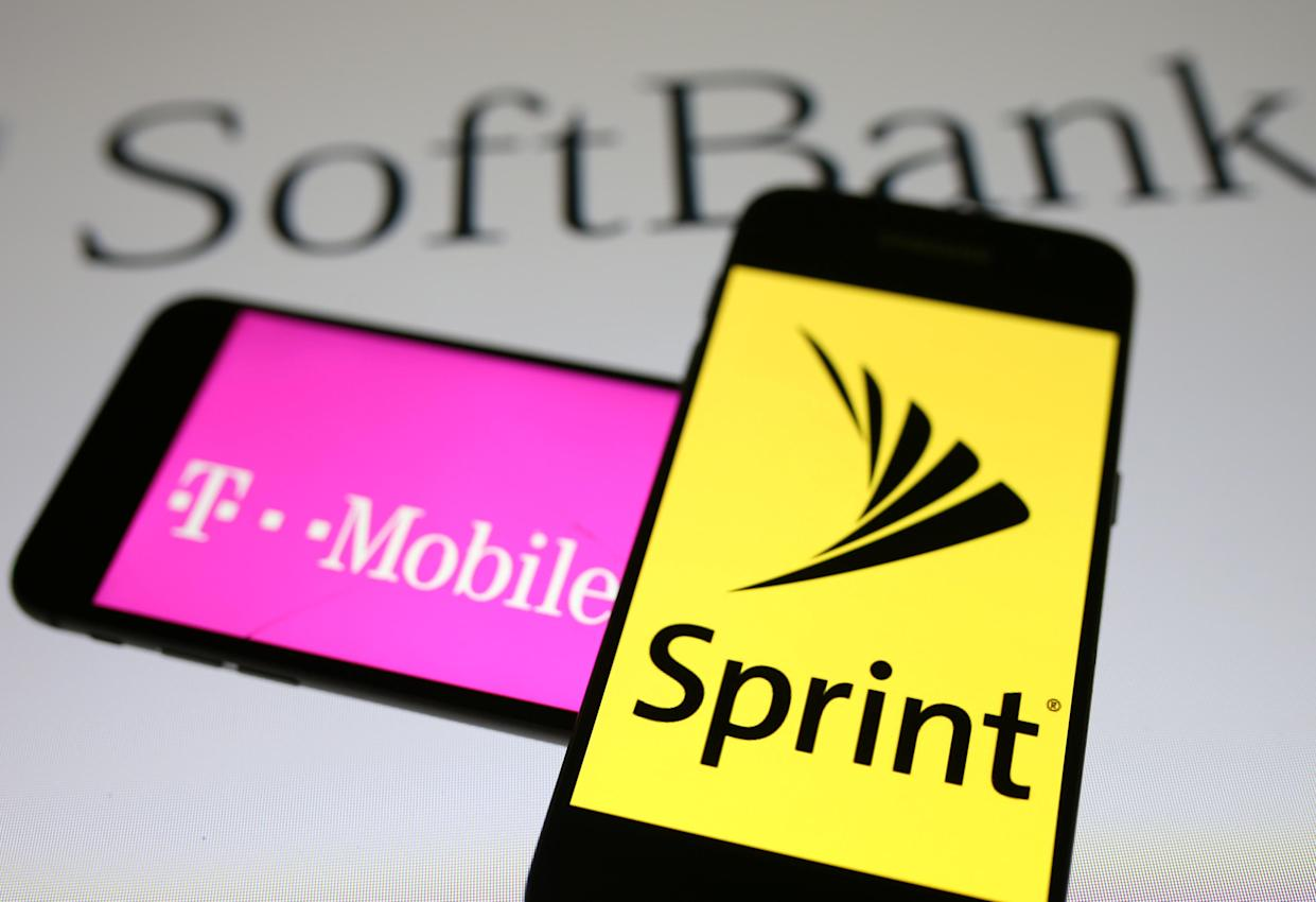 Smartphones with the logos of T-Mobile and Sprint are seen in front of a Soft Bank logo in this illustration taken September 19, 2017. REUTERS/Dado Ruvic/Illustrations