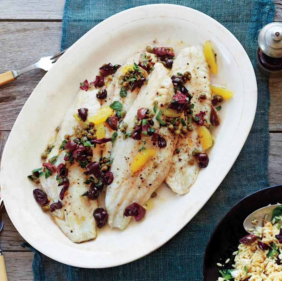 """Juicy lemon segments balance out the salad of briny olives, salty capers, and fragrant oregano that tops this quick and easy fish dish. <a href=""""https://www.epicurious.com/recipes/food/views/sea-bass-with-citrus-olive-caper-sauce-51170620?mbid=synd_yahoo_rss"""" rel=""""nofollow noopener"""" target=""""_blank"""" data-ylk=""""slk:See recipe."""" class=""""link rapid-noclick-resp"""">See recipe.</a>"""
