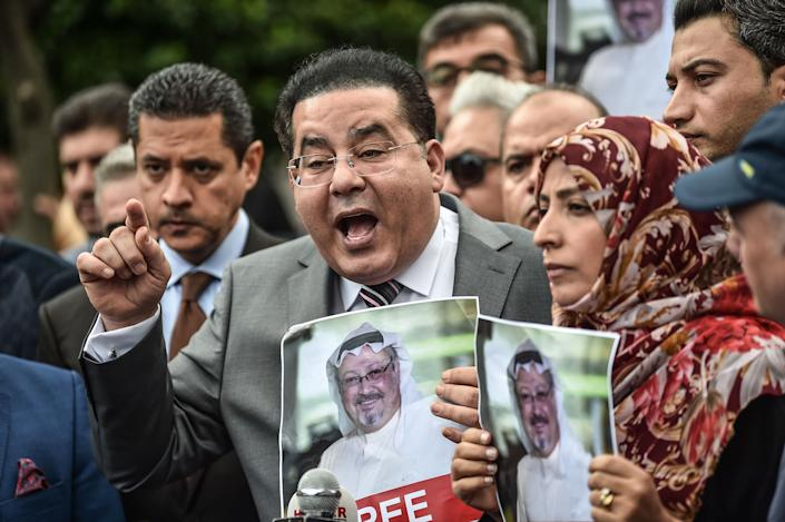 Egyptian opposition politican Ayman Nour (L), flanked by Nobel Peace Prize laureate Yemeni Tawakkol Karman (R), speaks during a press conference as they hold pictures of missing journalist Jamal Khashoggi during a demonstration in front of the Saudi Arabian consulate on October 8, 2018 in Istanbul. (Ozan Kose/AFP via Getty Images)
