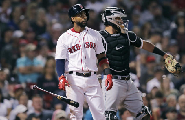 Boston Red Sox's Eduardo Nunez, left, drops his bat after striking out with the bases loaded during the sixth inning of a baseball game against the Chicago White Sox at Fenway Park in Boston, Monday, June 24, 2019. White Sox catcher James McCann, right, looks on. (AP Photo/Charles Krupa)