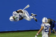 Indianapolis Colts running back Nyheim Hines (21) performs a somersault after a 22-yard run for a touchdown during the first half of an NFL football game against the Detroit Lions, Sunday, Nov. 1, 2020, in Detroit. (AP Photo/Carlos Osorio)