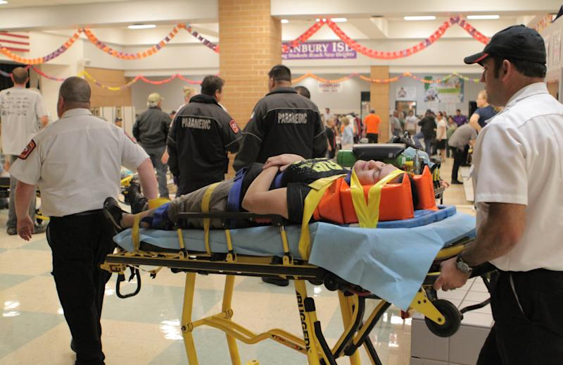 "An unidentified injured person is carried to an ambulance in Granbury, Texas, on Wednesday May 15, 2013. Officials report the tornado caused ""multiple fatalities"" as it tore through two neighborhoods of a North Texas town. Hood County sheriff's Lt. Kathy Jiveden reported the multiple fatalities, but she had no estimate of dead or injured. (AP Photo/Mike Fuentes)"