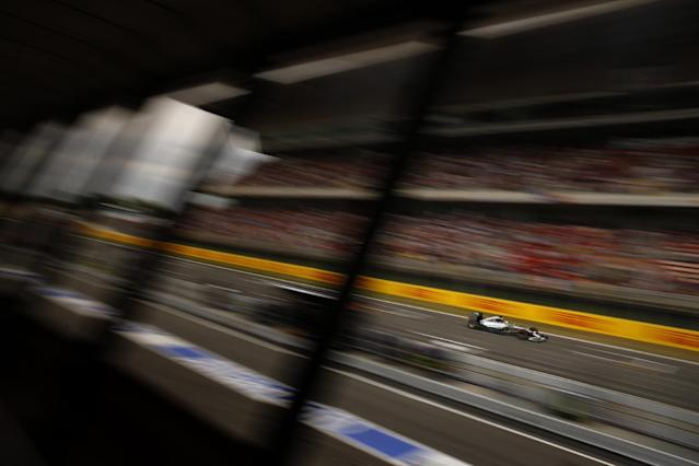Mercedes driver Lewis Hamilton of Britain steers his car before wining the Spain Formula One Grand Prix at the Barcelona Catalunya racetrack in Montmelo, near Barcelona, Spain, Sunday, May 11, 2014. (AP Photo/Emilio Morenatti)