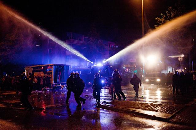 <p>German anti-riot police clash with protesters at Hamburg's Schanzenviertel, night before the beginning of G20, on July 6, 2017 in Hamburg, Germany. (Photo: Simon Becker/Le Pictorium/Barcroft Images/Getty Images </p>