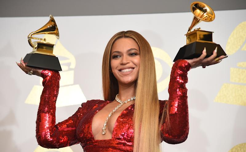 Singer Beyonce poses with her Grammy trophies in the press room during the 59th Annual Grammy music Awards on Feb. 12, 2017, in Los Angeles, Cali.