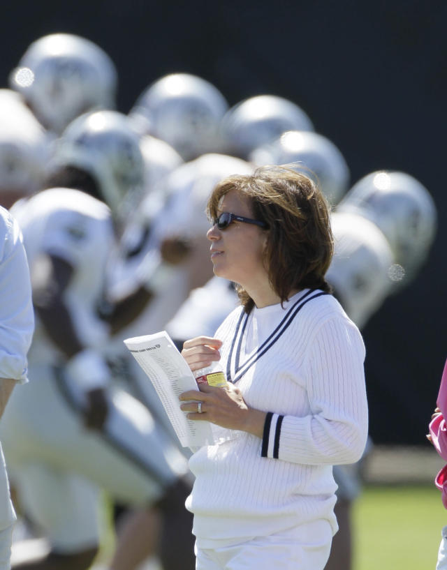 ADVANCE FOR WEEKEND EDITIONS, NOV. 8-9 - In this photo taken Aug. 4, 2011, former Oakland Raiders CEO Amy Trask stands on the sidelines during their NFL football training camp in Napa, Calif. The late Oakland Raiders owner Al Davis still comes to Trask's mind almost daily. Trask will see something or read something and wish she could share it with Davis. Along with her husband of nearly 29 years, Davis had one of the most profound influences on her life and career. Now 18 months removed from her almost three-decade stint with the franchise, Trask remains a loyal fan of the Raiders team she fell in love with as a college student at California-Berkeley. (AP Photo/Eric Risberg)