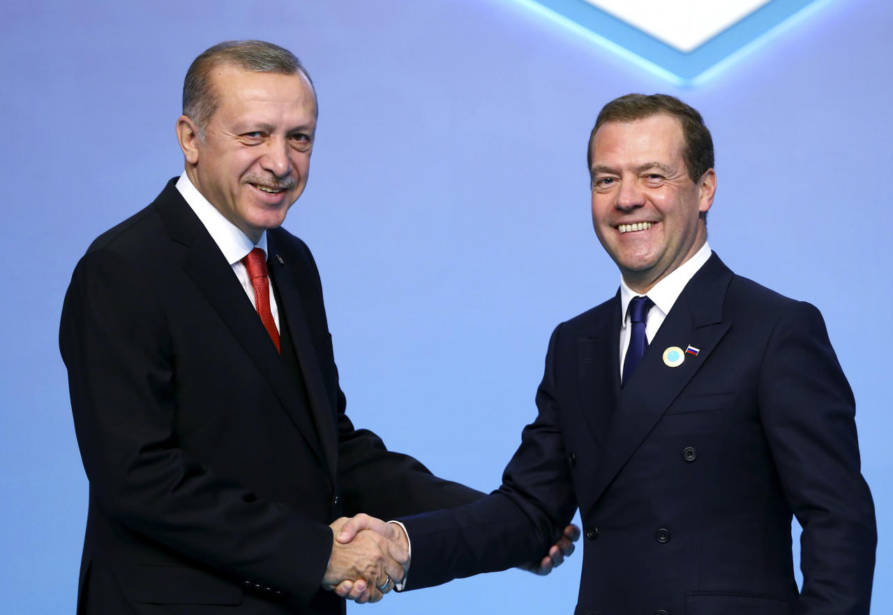 Turkey's President Recep Tayyip Erdogan, left, greets Russia's Prime Minister Dmitry Medvedev, at the 25th Anniversary Summit of the Organization of the Black Sea Economic Cooperation (BSEC) in Istanbul, Monday, May 22, 2017. (Pool Photo via AP)