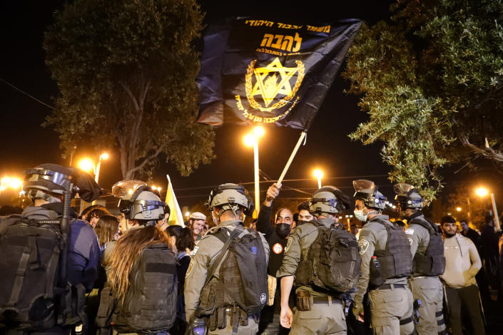 """Israeli border police block members of """"Lahava"""", a Jewish extremist group, to approach to Damascus Gate to protest amid heightened tensions in the city, just outside Jerusalem's Old City, Thursday, April. 22, 2021. (AP Photo/Ariel Schalit)"""