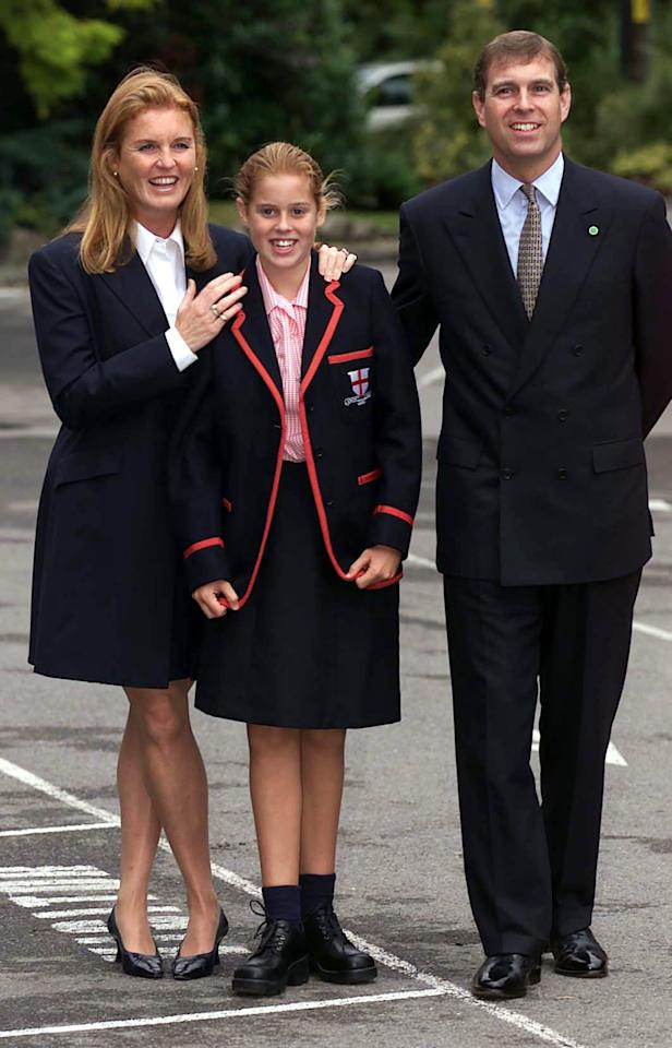 Princess Beatrice arrives for her first day at St George's School in Ascot, Berkshire, with her parents the Duke and Duchess of York, in 2000. [Photo: PA]