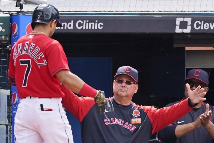 Cleveland Indians manager Terry Francona, right, congratulates Cesar Hernandez after Hernandez hit a solo home run in the third inning of the first baseball game of a doubleheader against the Chicago White Sox, Monday, May 31, 2021, in Cleveland. (AP Photo/Tony Dejak)