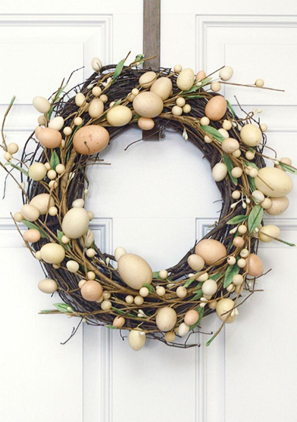 """<p>If you're not that into pastels, this neutral-colored wreath may be more up your alley. Plus, you'll only need two items to make it! </p><p><strong>Get the tutorial at <a href=""""https://livelaughrowe.com/diy-easter-wreath/"""" rel=""""nofollow noopener"""" target=""""_blank"""" data-ylk=""""slk:Live Laugh Rowe"""" class=""""link rapid-noclick-resp"""">Live Laugh Rowe</a>. </strong></p><p><strong><strong><a class=""""link rapid-noclick-resp"""" href=""""https://www.amazon.com/Bulk-Buy-Darice-Grapevine-Wreath/dp/B0033M0HG4?tag=syn-yahoo-20&ascsubtag=%5Bartid%7C10050.g.4088%5Bsrc%7Cyahoo-us"""" rel=""""nofollow noopener"""" target=""""_blank"""" data-ylk=""""slk:SHOP GRAPEVINE WREATHS"""">SHOP GRAPEVINE WREATHS</a></strong><br></strong></p>"""