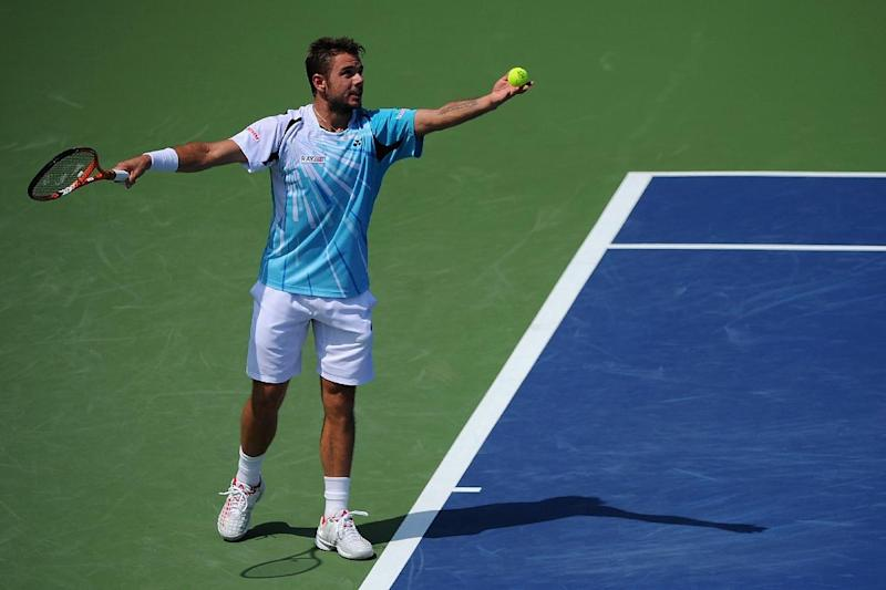 Stan Wawrinka of Switzerland serves against Marin Cilic of Croatia during a match on day 6 of the Western & Southern Open at the Linder Family Tennis Center on August 14, 2014 in Cincinnati, Ohio