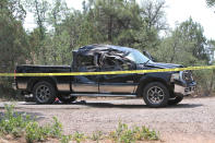 This Saturday, June 19, 2021, photo courtesy of The White Mountain Independent shows a damaged pickup truck which ran over a group of cyclists in Show Low, Ariz. A driver in a pickup truck plowed into bicyclists competing in a community road race in Arizona on Saturday, critically injuring several riders before police chased down the driver and shot him outside a nearby hardware store, police said. Police say the cyclists have been taken to a hospital in critical condition after the crash. (Jim Headley/The White Mountain Independent via AP)