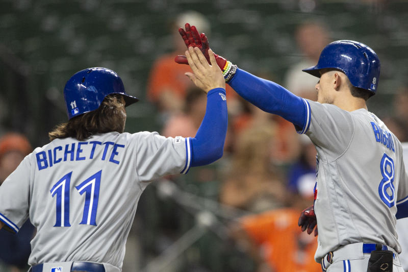 Sep 17, 2019; Baltimore, MD, USA; Toronto Blue Jays second baseman Cavan Biggio (8) high fives shortstop Bo Bichette (11) at home plate after hitting a two run home run against the Baltimore Orioles at Oriole Park at Camden Yards. Mandatory Credit: Tommy Gilligan-USA TODAY Sports