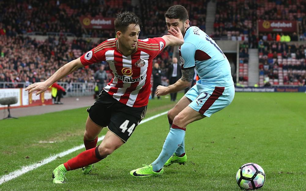 Adnan Januzaj of Sunderland (L) attempts to take the balll past Robbie Brady of Burnley - Credit: Getty Images