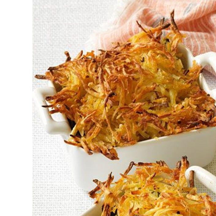 """<p>Succulent fish and seafood become a decadent dish when mixed into a creamy sauce topped with a crispy, shredded potato crust.</p><p><a href=""""https://www.womansday.com/food-recipes/food-drinks/recipes/a12460/seafood-bake-crispy-hash-brown-topping-recipe-wdy0314/"""" rel=""""nofollow noopener"""" target=""""_blank"""" data-ylk=""""slk:Get the Seafood Bake with Crispy Hash Brown Topping recipe."""" class=""""link rapid-noclick-resp""""><em>Get the Seafood Bake with Crispy Hash Brown Topping recipe.</em></a></p>"""
