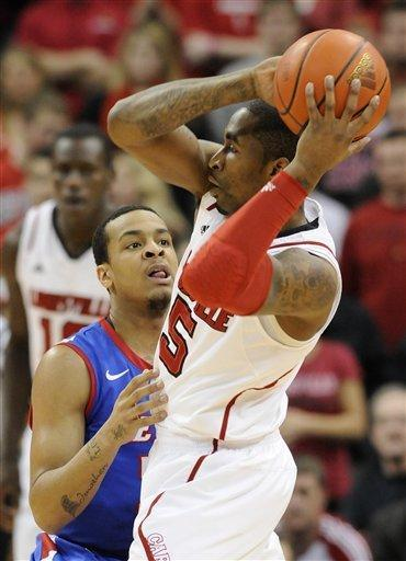 DePaul's Brandon Young, left, pressures Louisville's Chris Smith during the first half of their NCAA college basketball game Saturday, Jan. 14, 2012 in Louisville, Ky. (AP Photo/Timothy D. Easley)