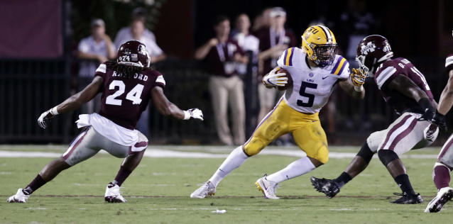 "LSU running back <a class=""link rapid-noclick-resp"" href=""/ncaaf/players/250978/"" data-ylk=""slk:Derrius Guice"">Derrius Guice</a> (5) tries to run away from Mississippi State defensive back Chris Rayford (24) and linebacker Dezmond Harris (11) during the first half of their NCAA college football game against in Starkville, Miss., Saturday, Sept. 16, 2017. (AP Photo/Rogelio V. Solis)"