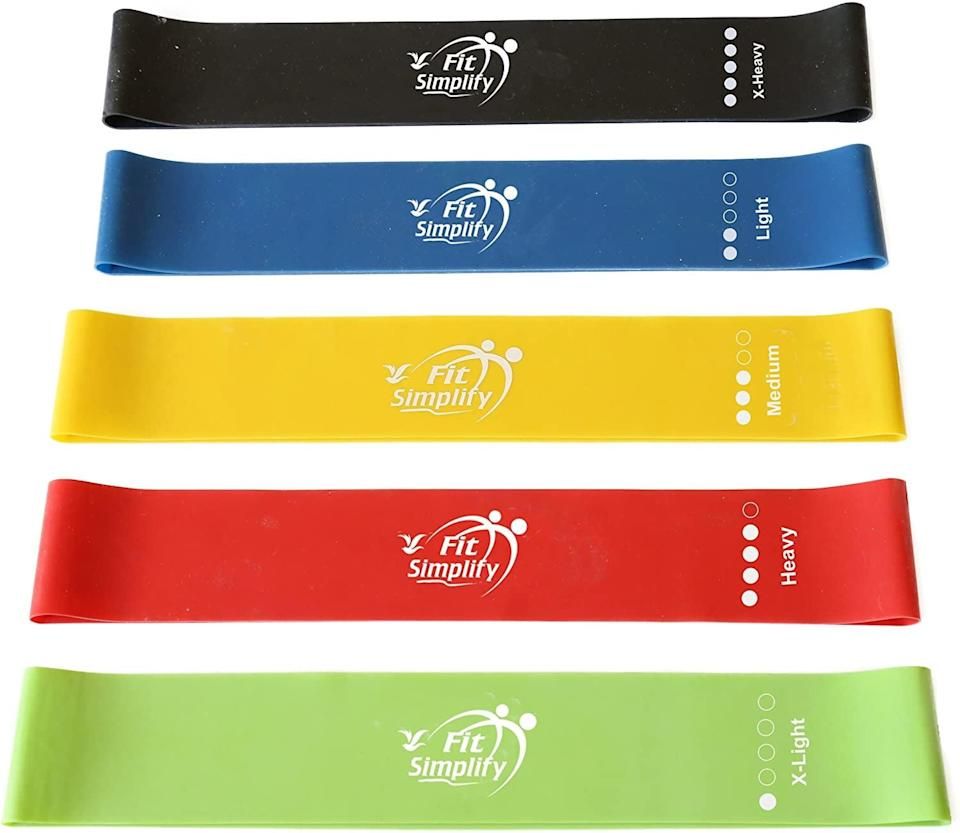 """<p>""""Working out from home can get boring, especially since I have minimal equipment. These <span>Fit Simply Mini Resistance Loop Bands</span> ($12) have added a challenge to my normal bodyweight moves, and I've gotten sore by using them for squats, glute bridges, and more. They are small and lightweight so they are easy to store and travel with. Plus, for $12 for a pack of five, you can't beat the price!"""" - Christina Stiehl, senior editor, Fitness</p>"""