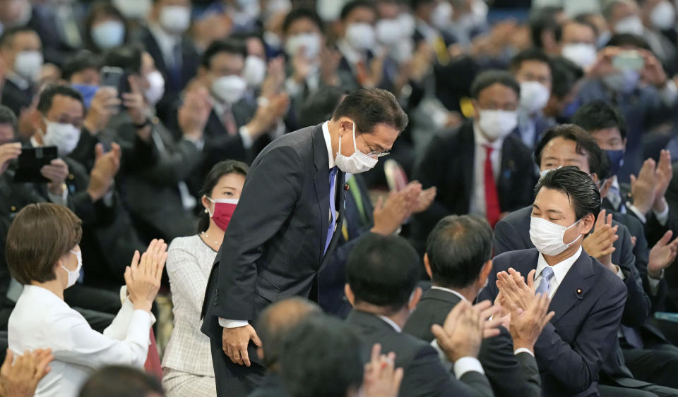 Japan's former Foreign Minister Fumio Kishida bows as he won in the Liberal Democrat Party leadership election in Tokyo Wednesday, Sept. 29, 2021. Kishida has won the governing party leadership election and is set to be become the next prime minister. (Kyodo News via AP)