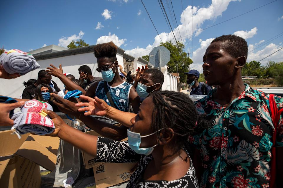 Haitian migrants are given donations from Mexicans in Ciudad Acuna as they arrive at the border city with hopes of entering the U.S. through Del Rio, Texas.