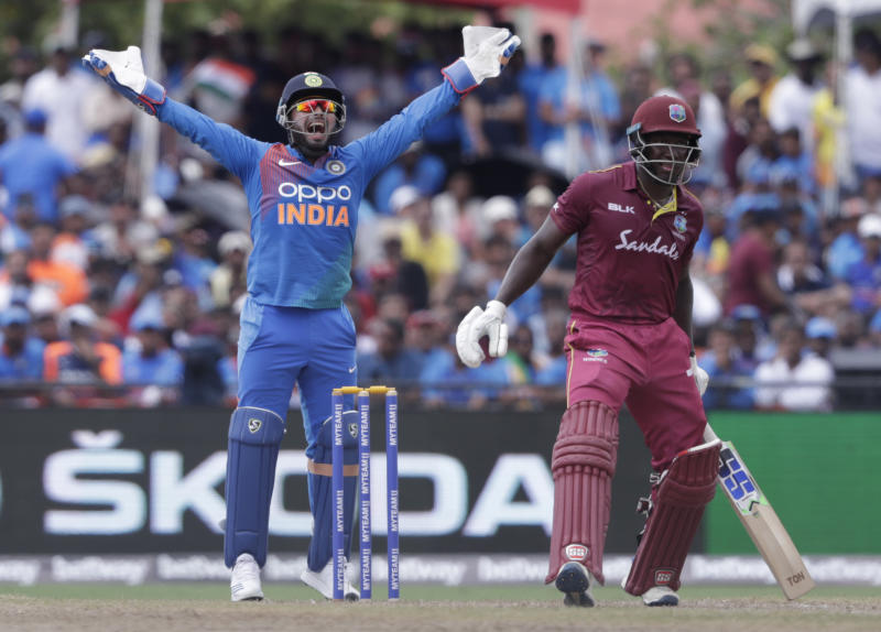 India wicket keeper Rishabh Pant, left, makes a successful LBW appeal on West Indies' Rovman Powell, right, who was out off the bowling of Krunal Pandya during the second Twenty20 international cricket match, Sunday, Aug. 4, 2019, in Lauderhill, Fla. (AP Photo/Lynne Sladky)