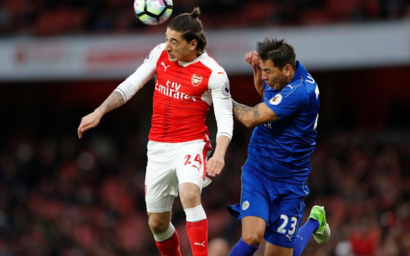 Arsenal's Hector Bellerin in action with Leicester City's Leonardo Ulloa - Credit: REUTERS